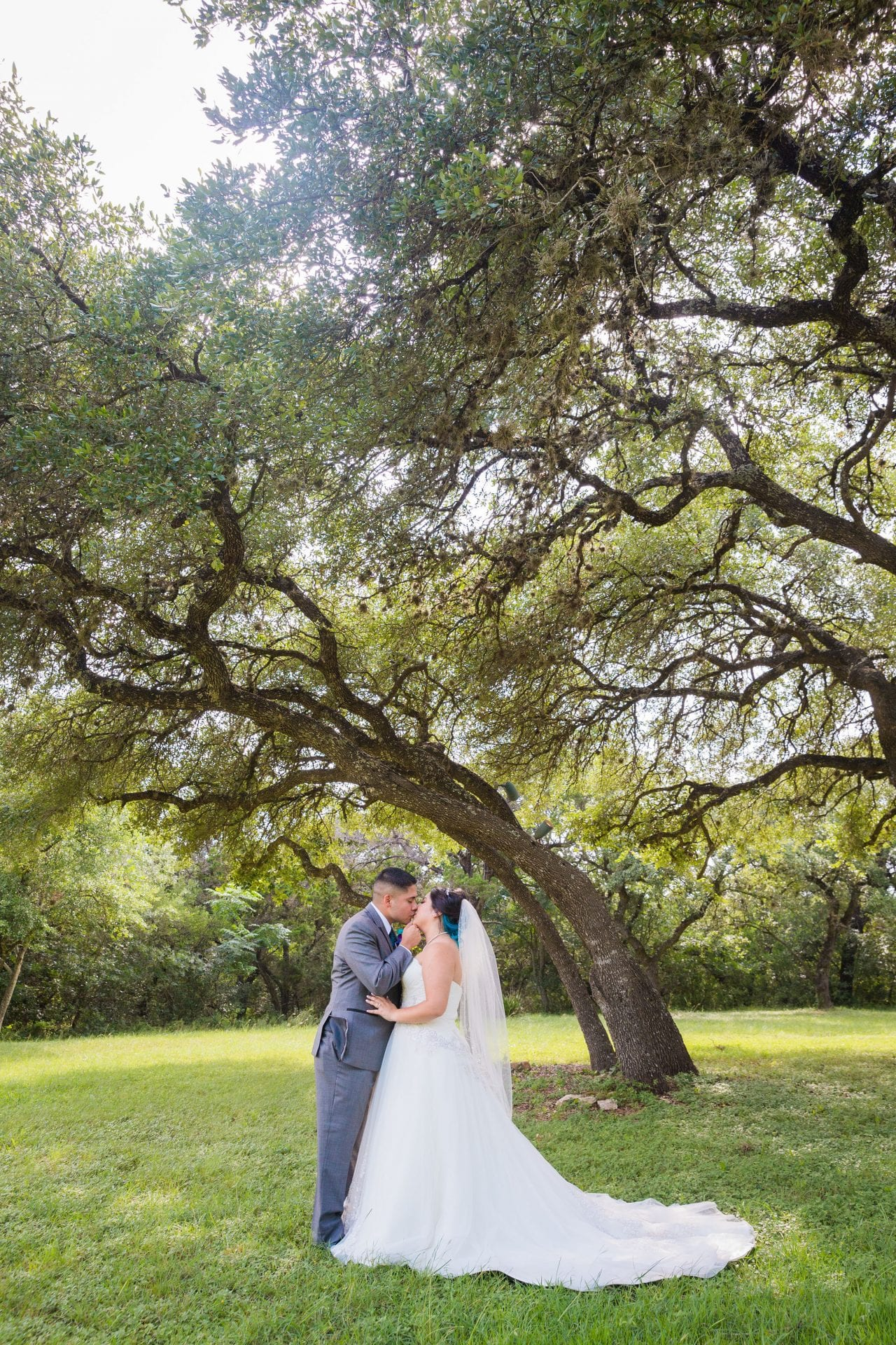 Alex and Adrien Wedding at The Gardens at Old Town couple under tree
