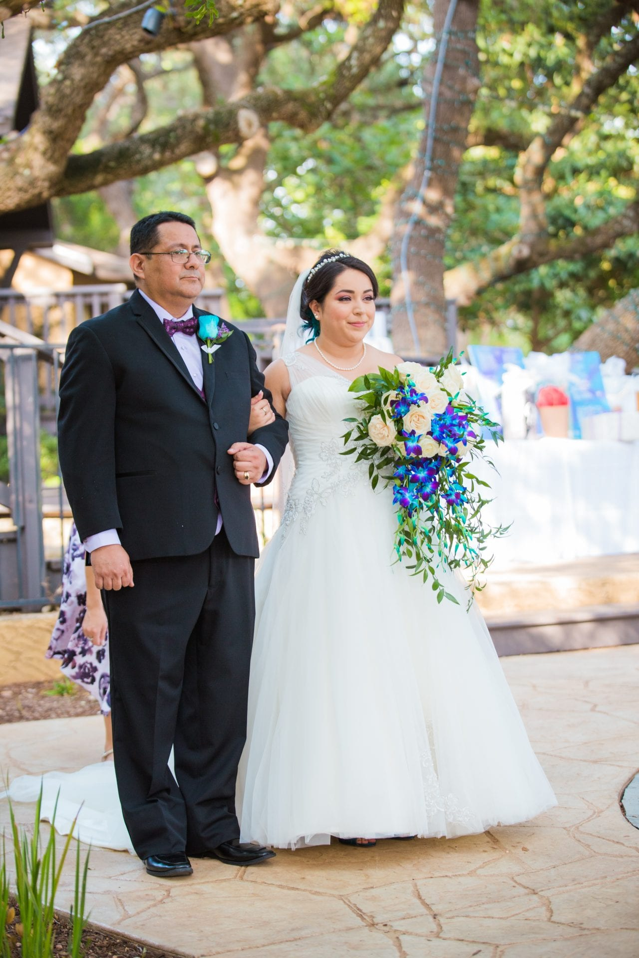 Alex and Adrien Wedding at The Gardens at Old Town walk aisle