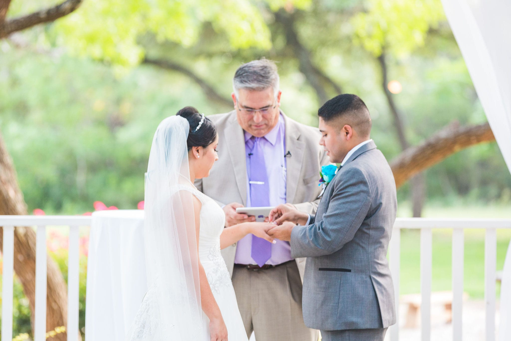 Alex and Adrien Wedding at The Gardens at Old Town ceremony ring exchange