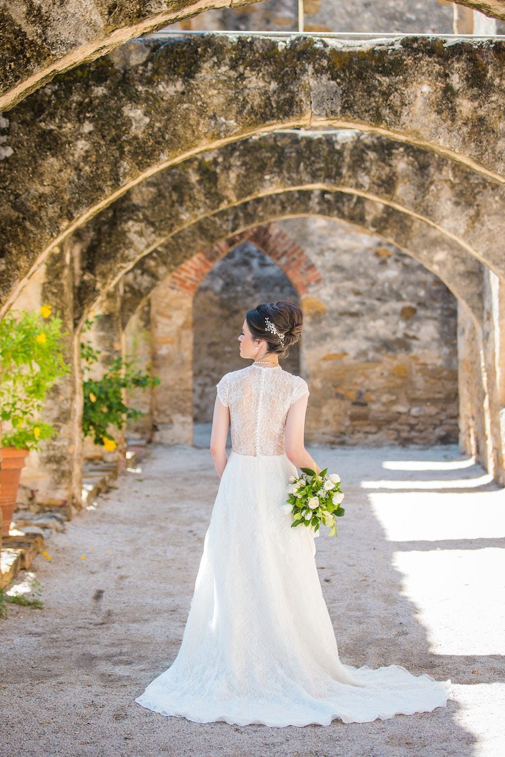 Aamber's bridal - mission San Jose back of her in the arches