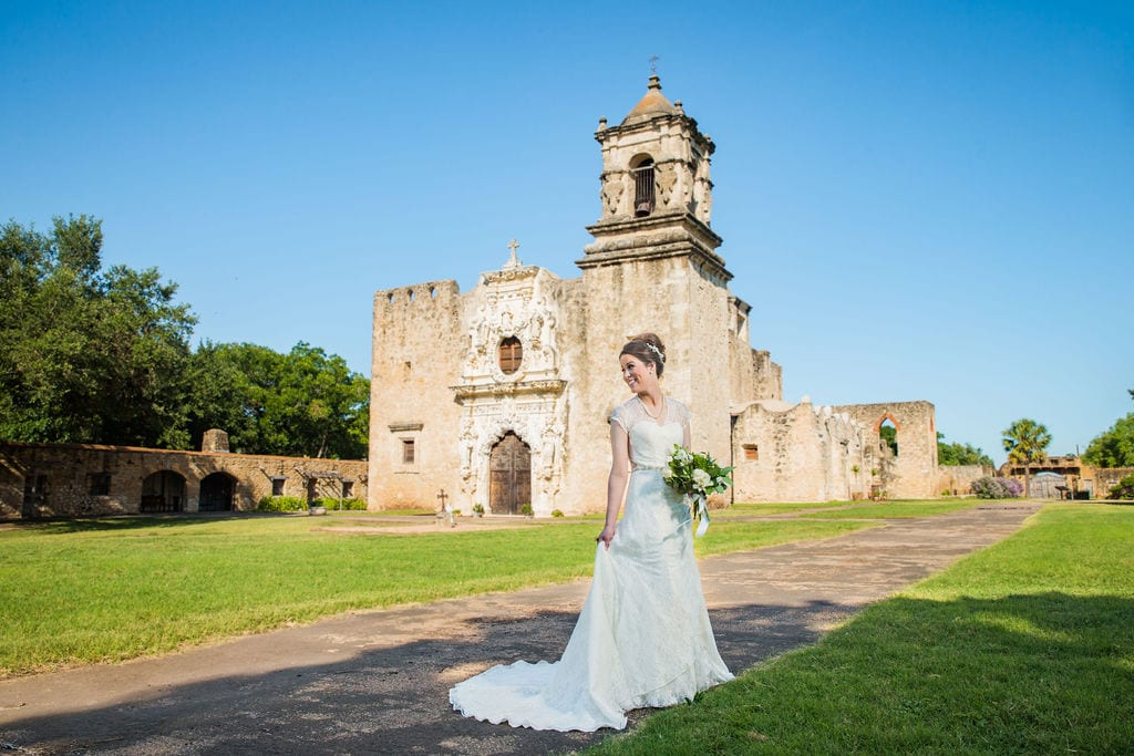 Aamber's bridal - front of mission San Jose with bride looking back