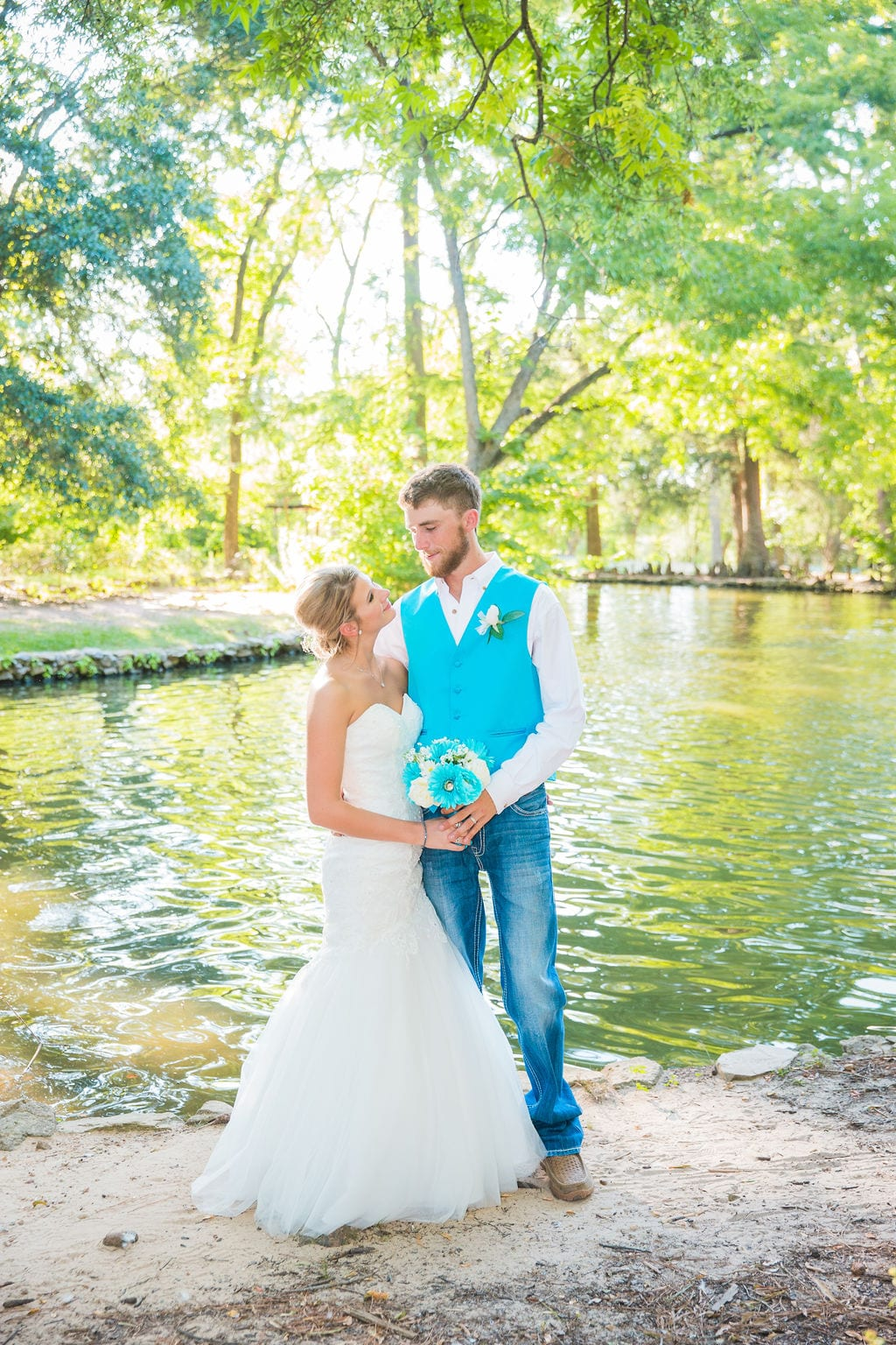 Courtney and Bearen's Wedding couple by pond