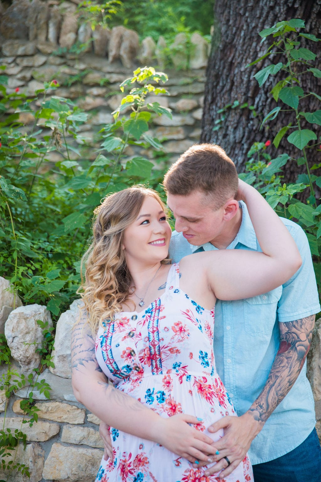 Kristina and Brandon Engagement session Japanese tea gardens her holding his head