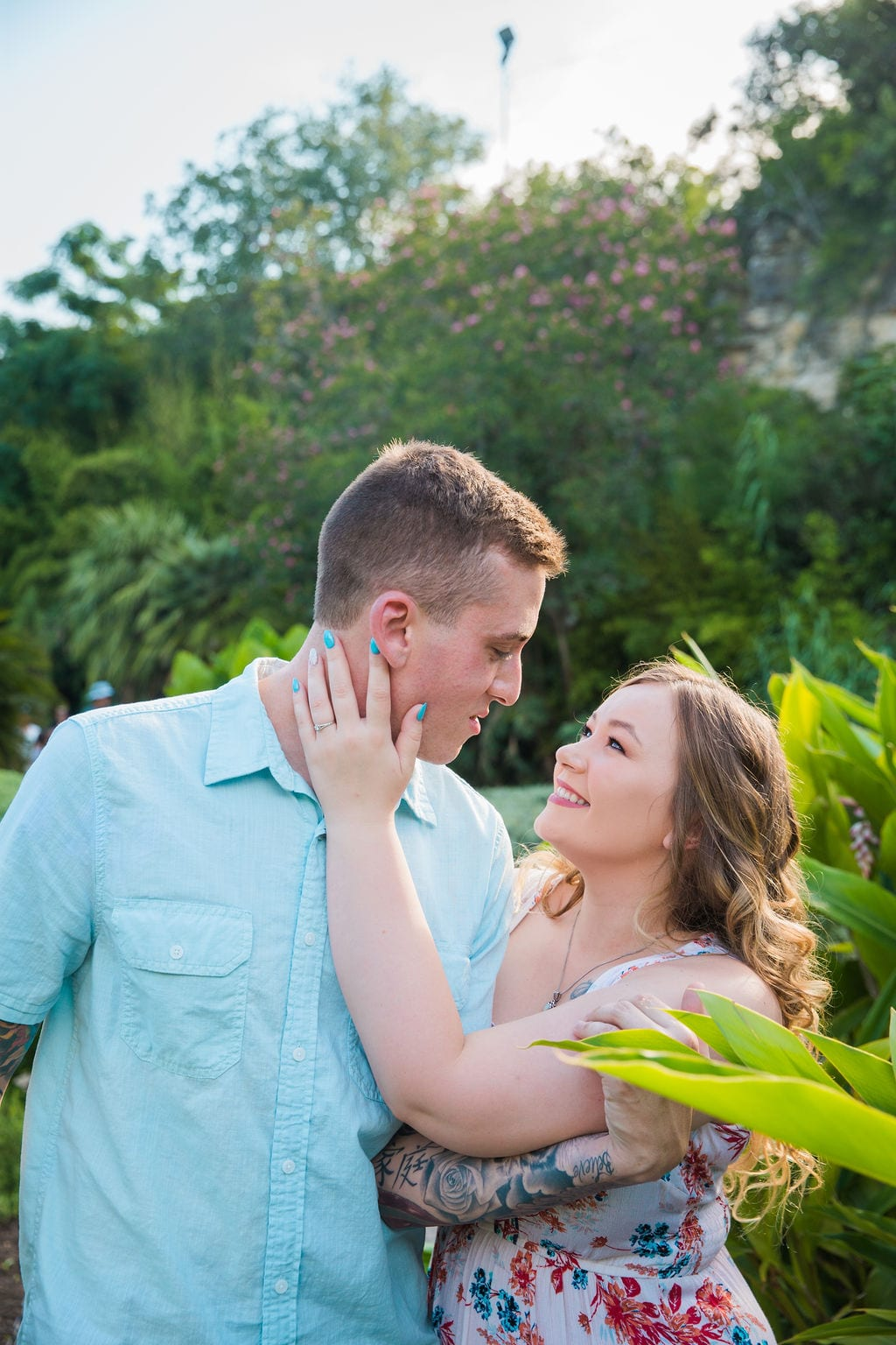 Kristina and Brandon Engagement session Japanese tea gardens his face