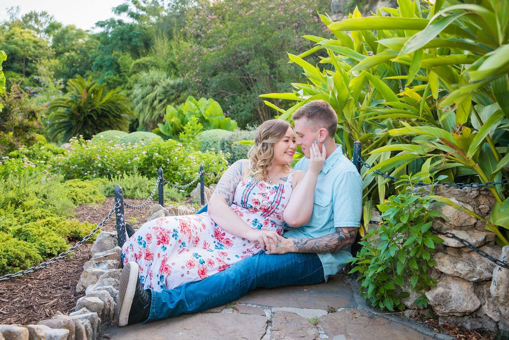 Kristina and Brandon Engagement session Japanese tea gardens sitting on the ground