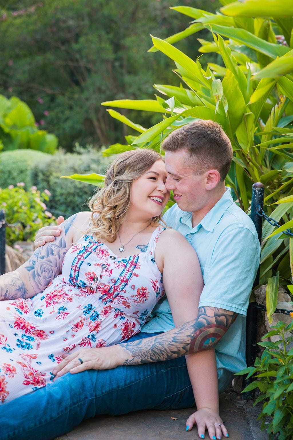 Kristina and Brandon Engagement session Japanese tea gardens sitting on the ground close up