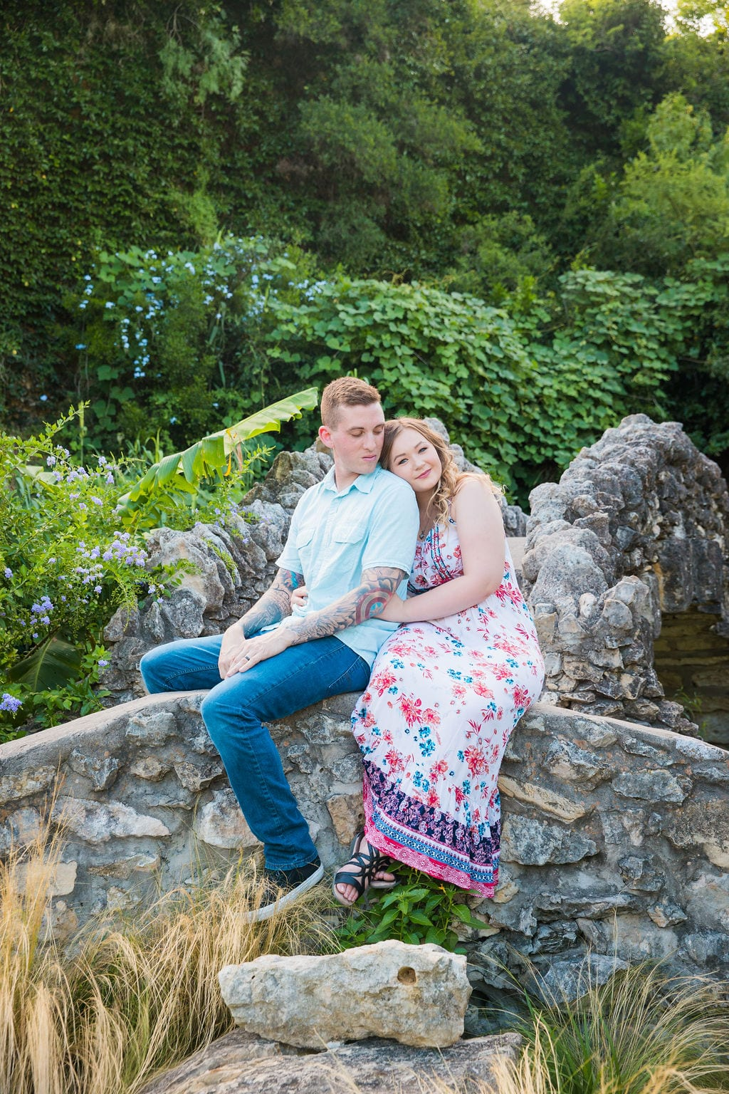 Kristina and Brandon Engagement session Japanese tea gardens sitting on the bridge