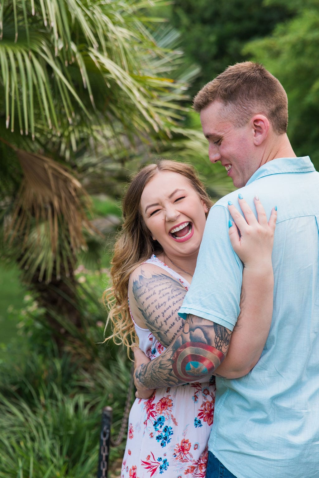 Kristina and Brandon Engagement session Japanese tea gardens her laughing