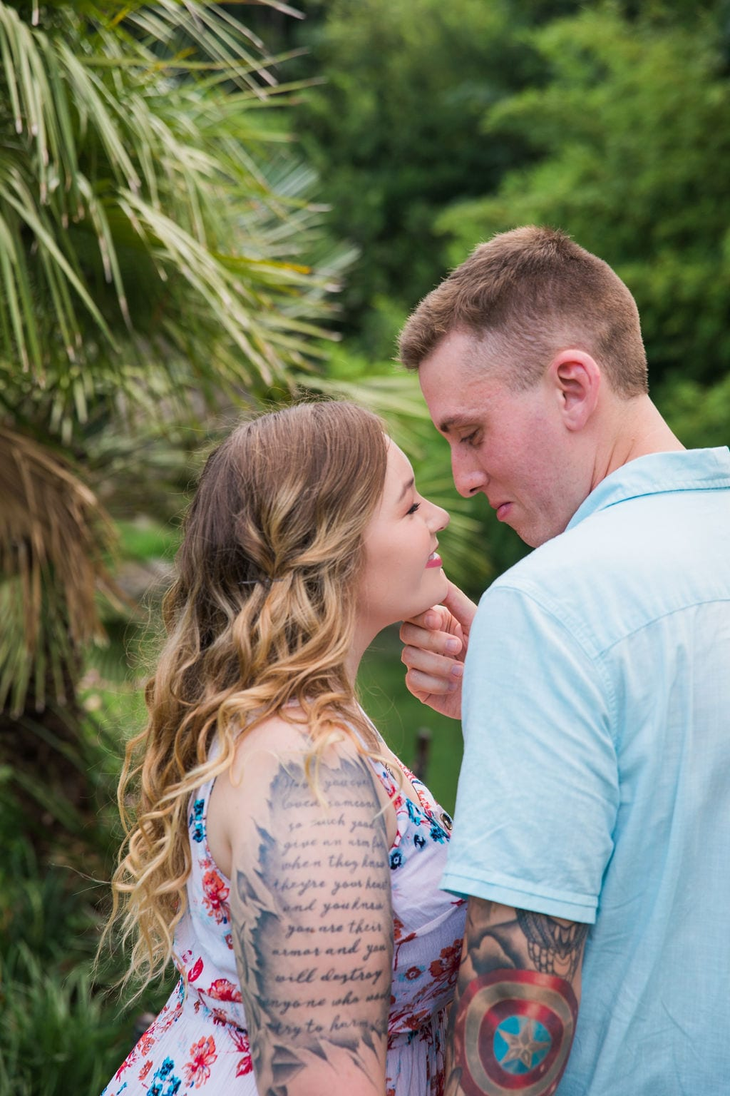 Kristina and Brandon Engagement session Japanese tea gardens holding her chin