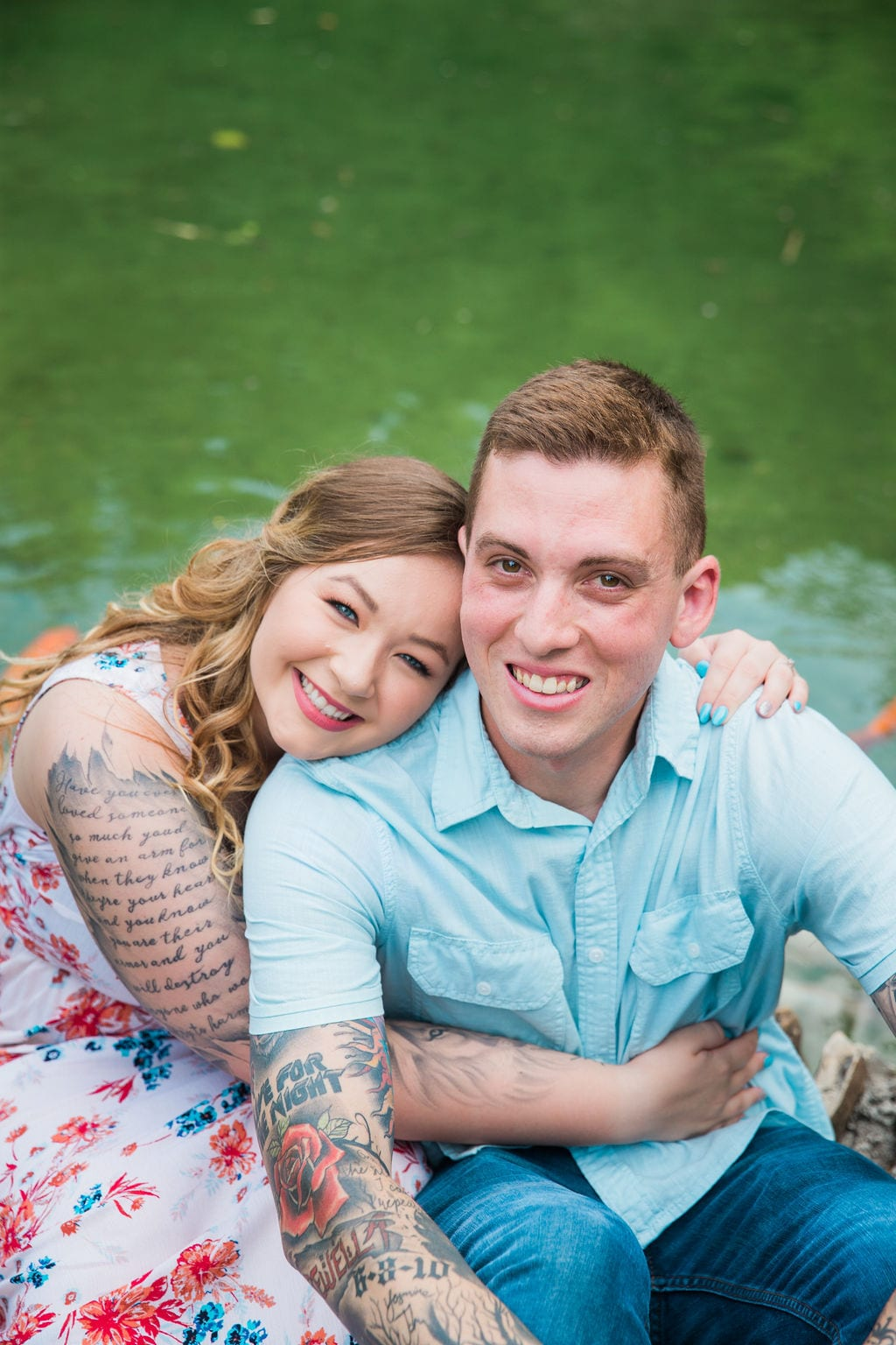 Kristina and Brandon Engagement session Japanese tea gardens her holding him