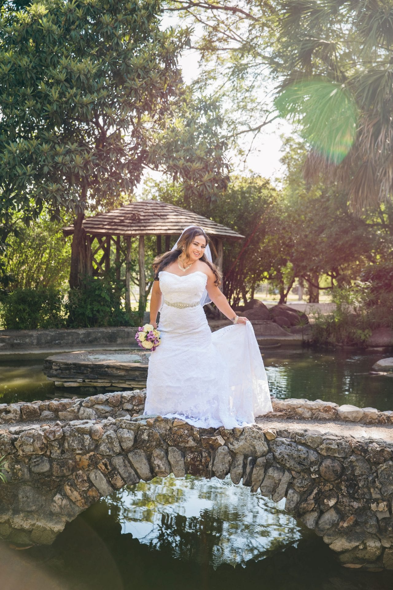 Linda's bridal session at the McNay on bridge with sunlight