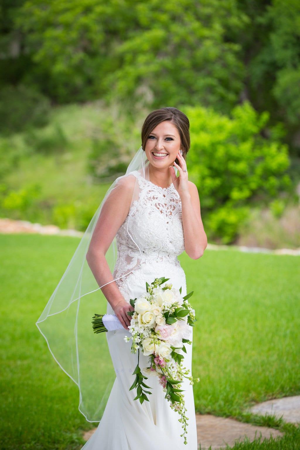 Samantha's Bridal Hidden Falls on the green smiling