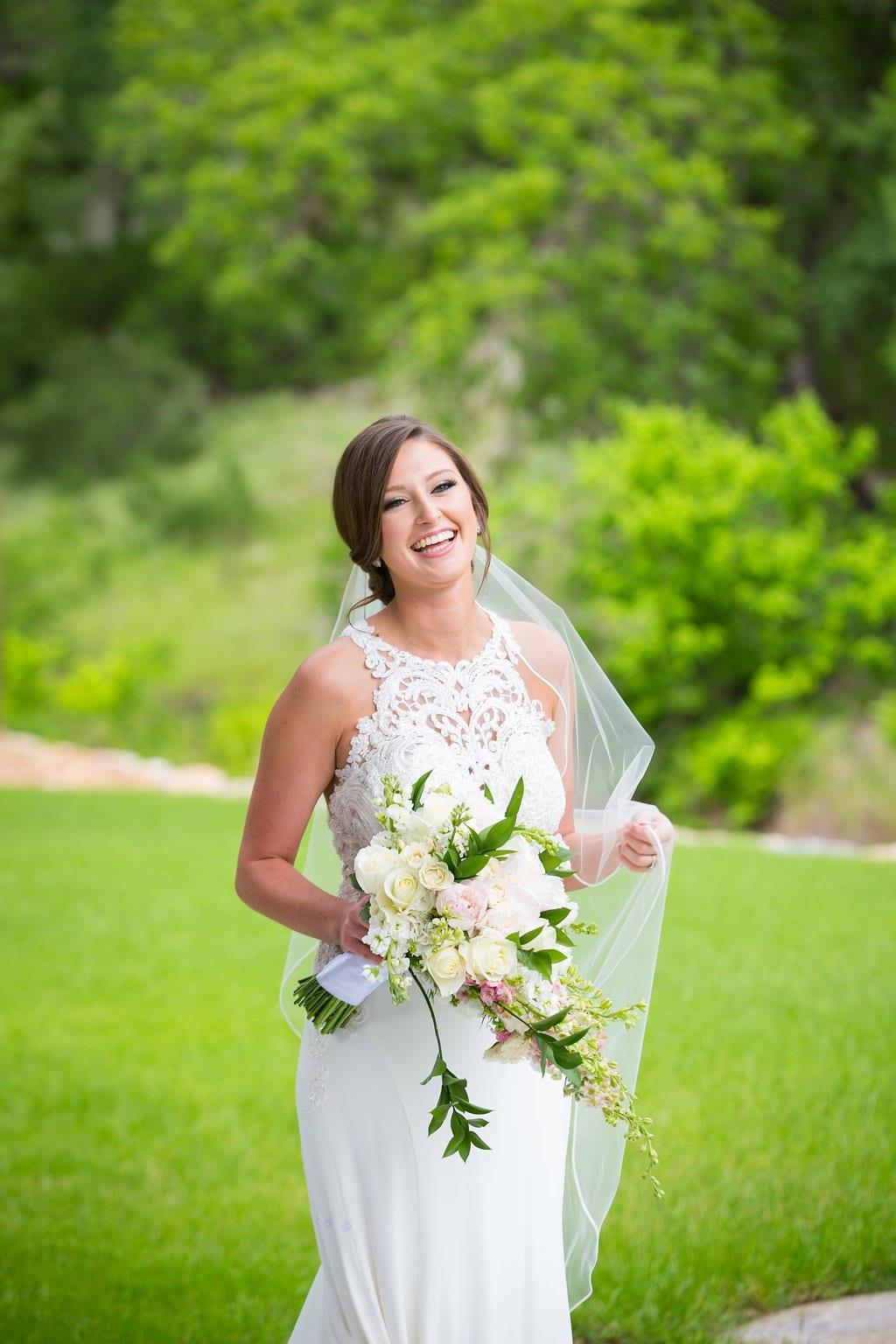 Samantha's Bridal Hidden Falls on the green laughing