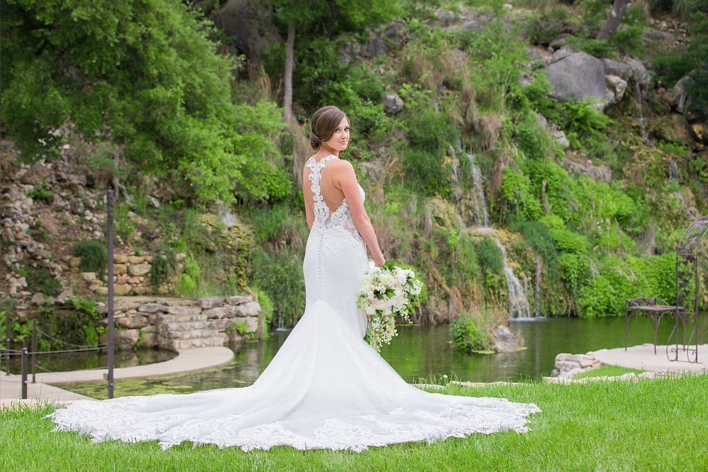 Samantha's Bridal Hidden Falls back of gown on the green