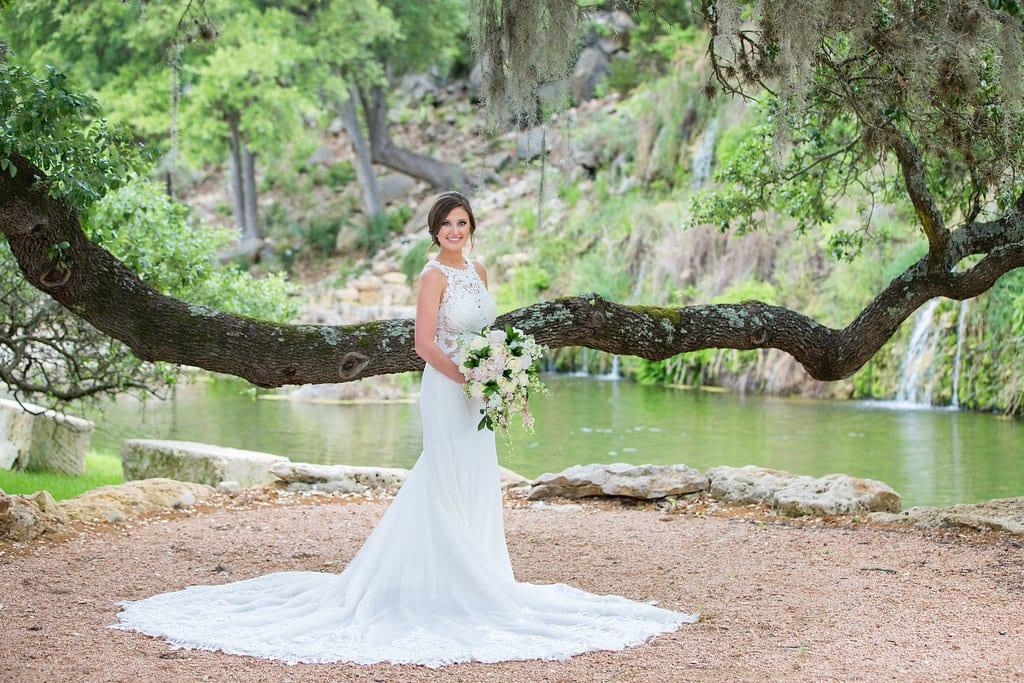 Samantha's Bridal Hidden Falls back of gown under the tree