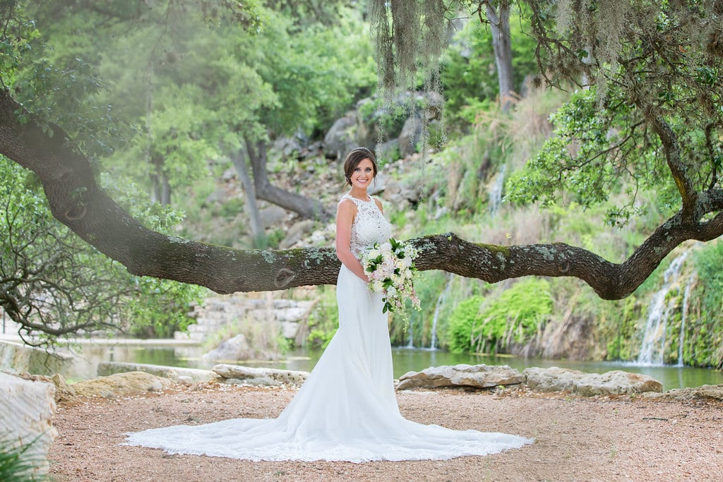 Samantha's Bridal Hidden Falls back of gown under the tree moss