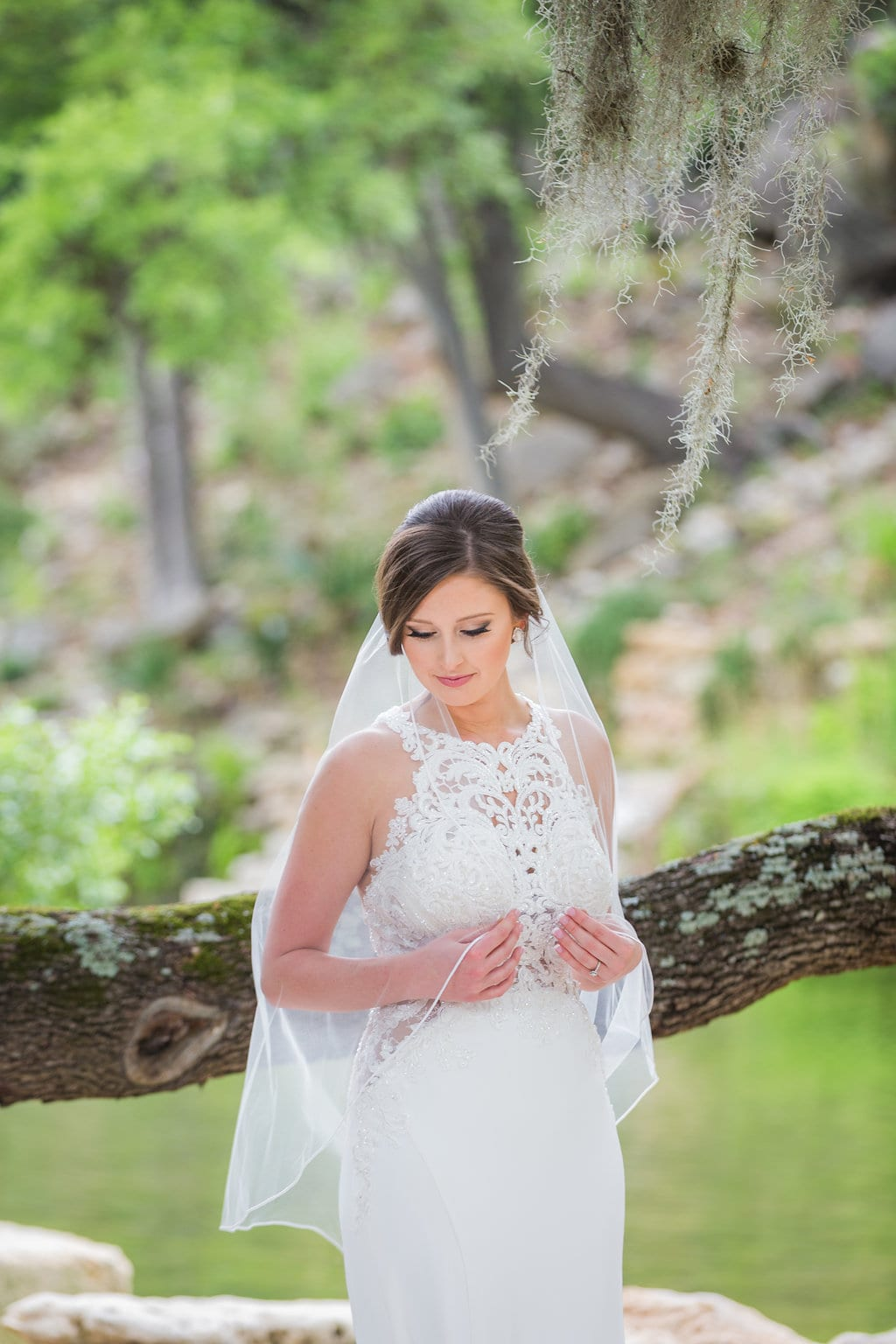 Samantha's Bridal Hidden Falls back of gown under the tree close up pensive