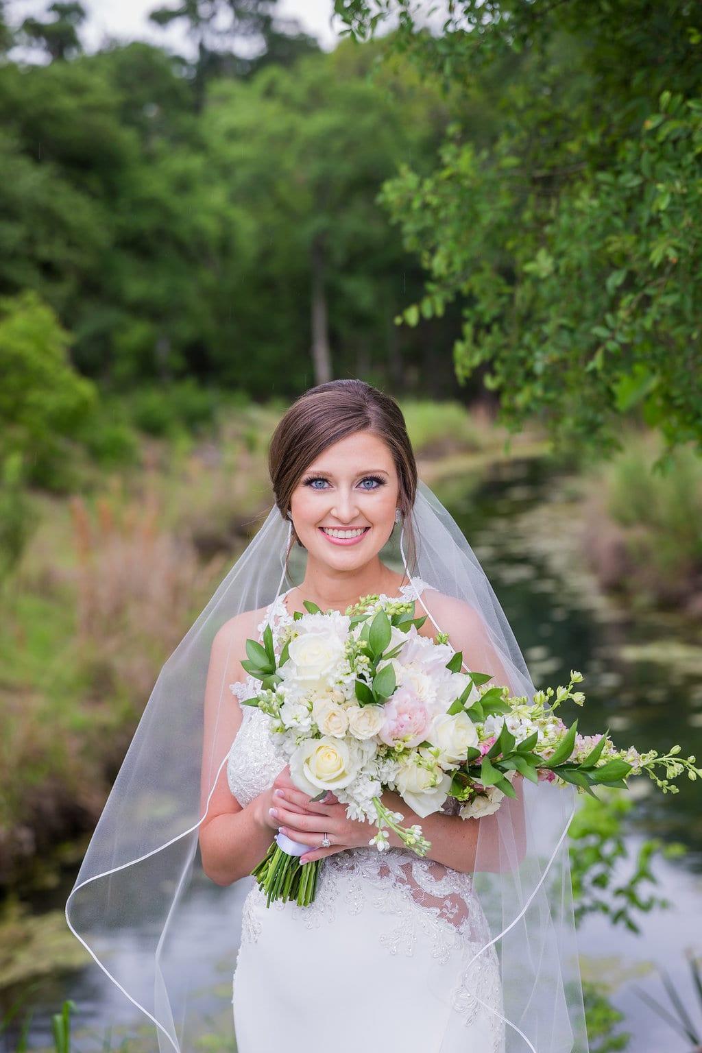 Samantha's Bridal Hidden Falls close up at the creek smiling