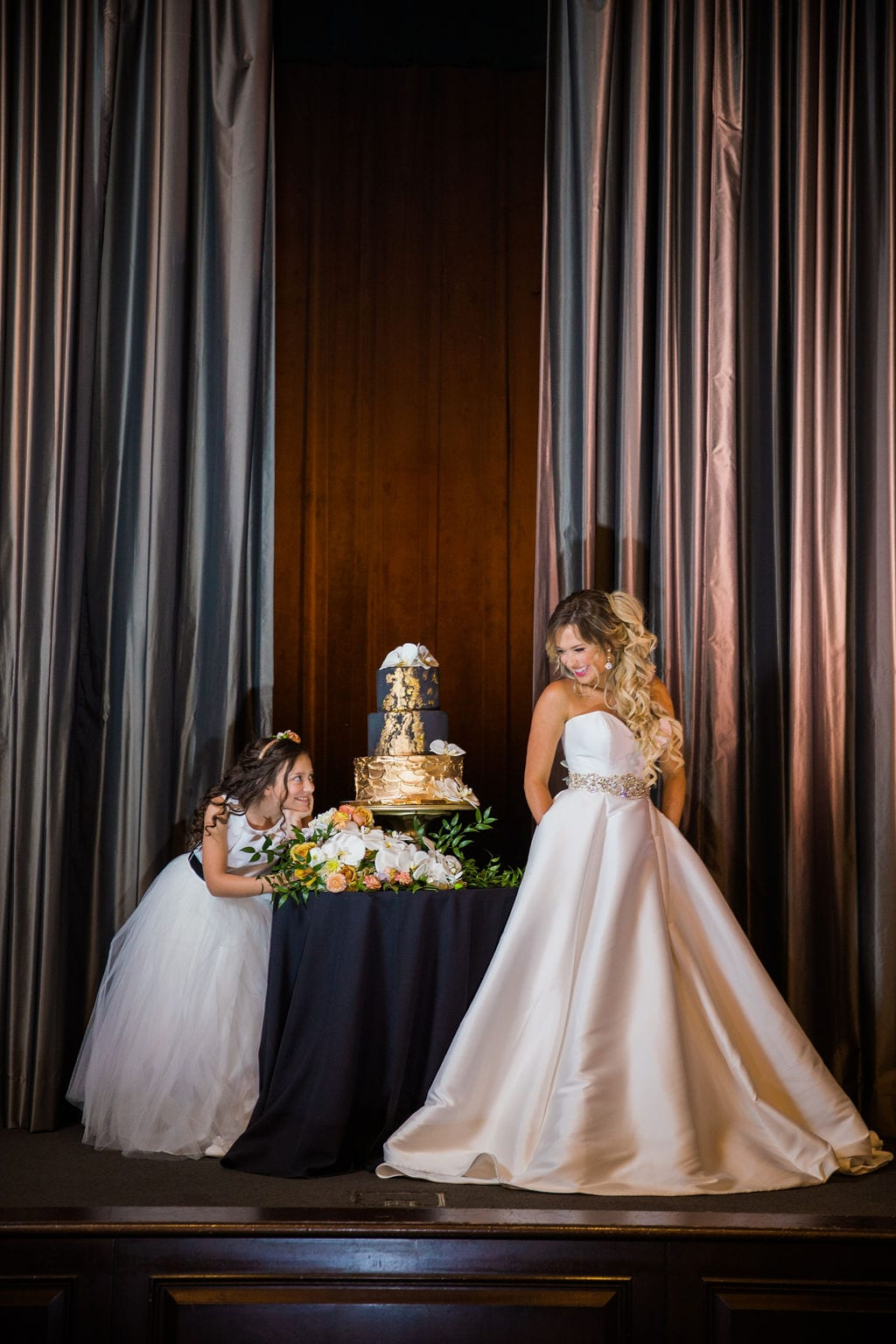 St Anthony Styled wedding cake with bride and flower girl