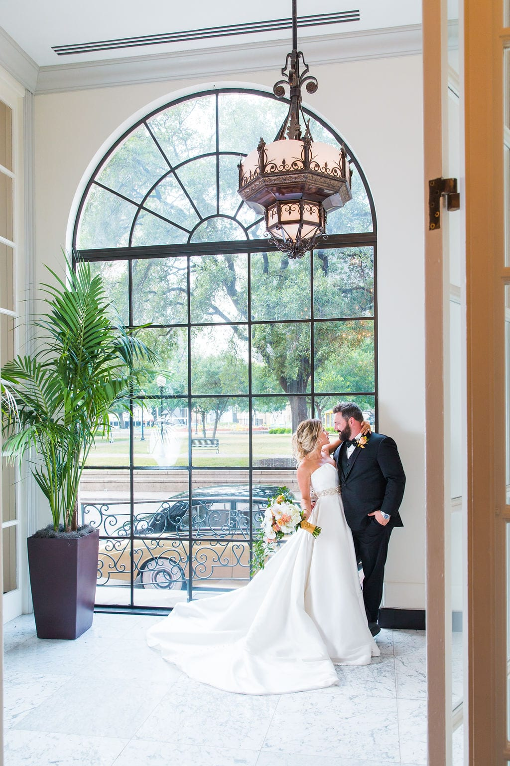 St Anthony Styled wedding bride and groom by window