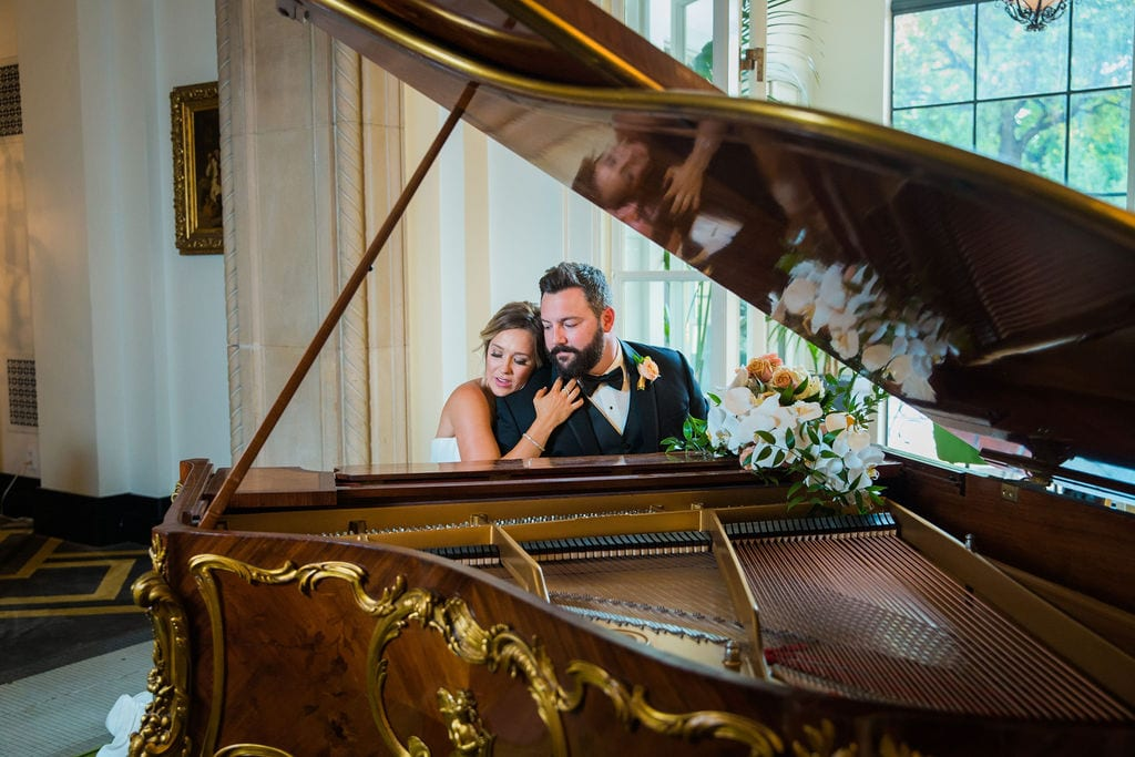 St Anthony Styled wedding couple at the piano hugging