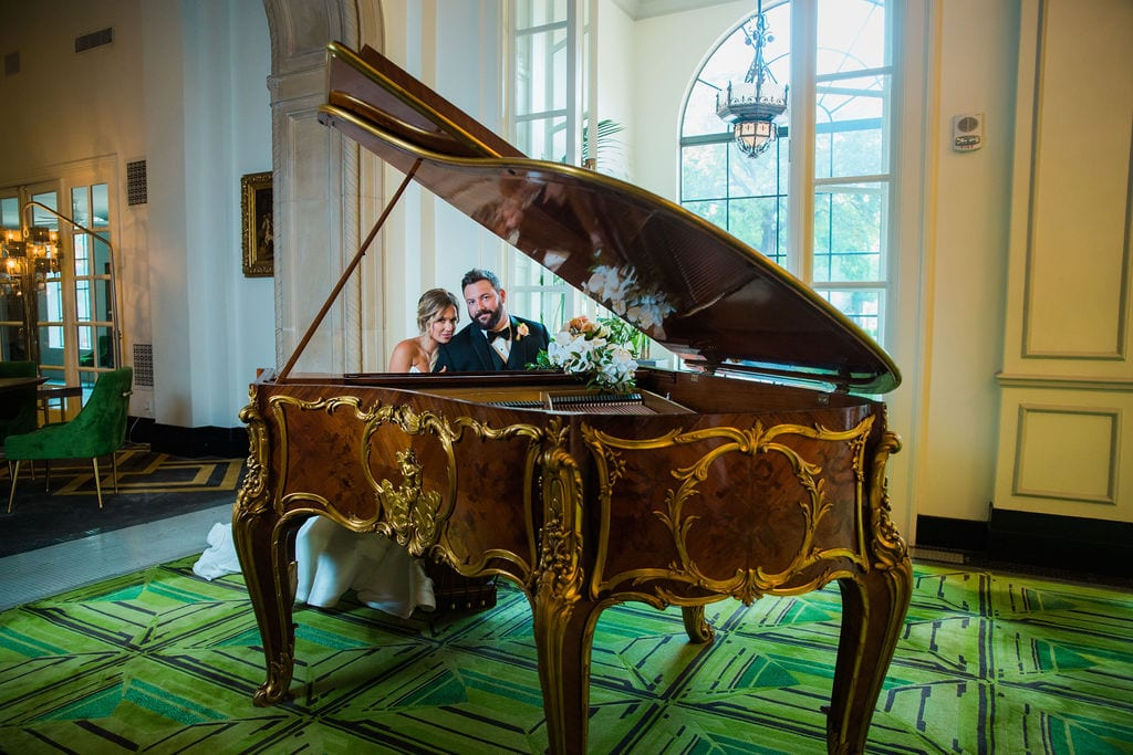 St Anthony Styled wedding couple at the piano playing