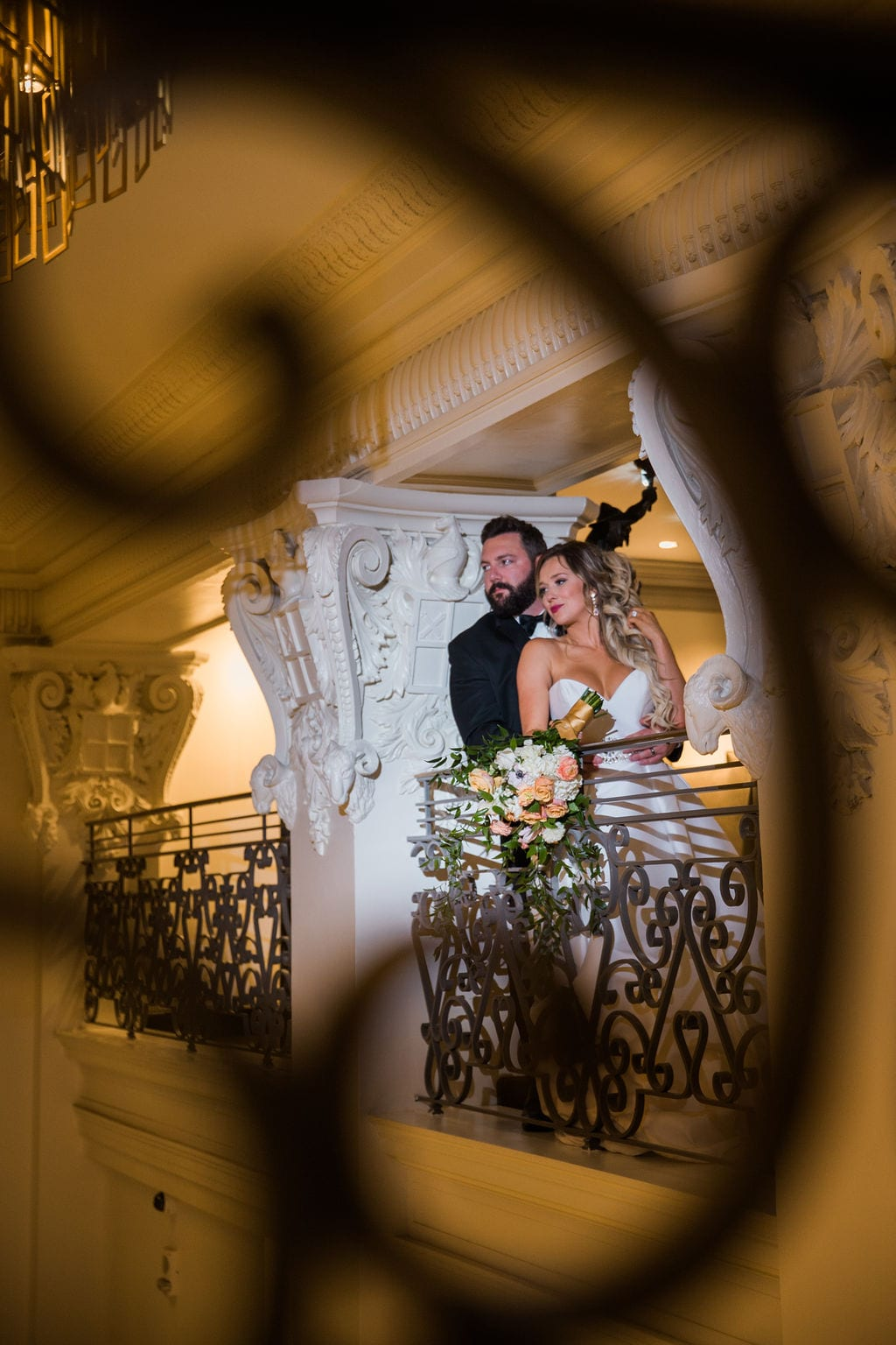 St Anthony Styled wedding groom and bride on balcony