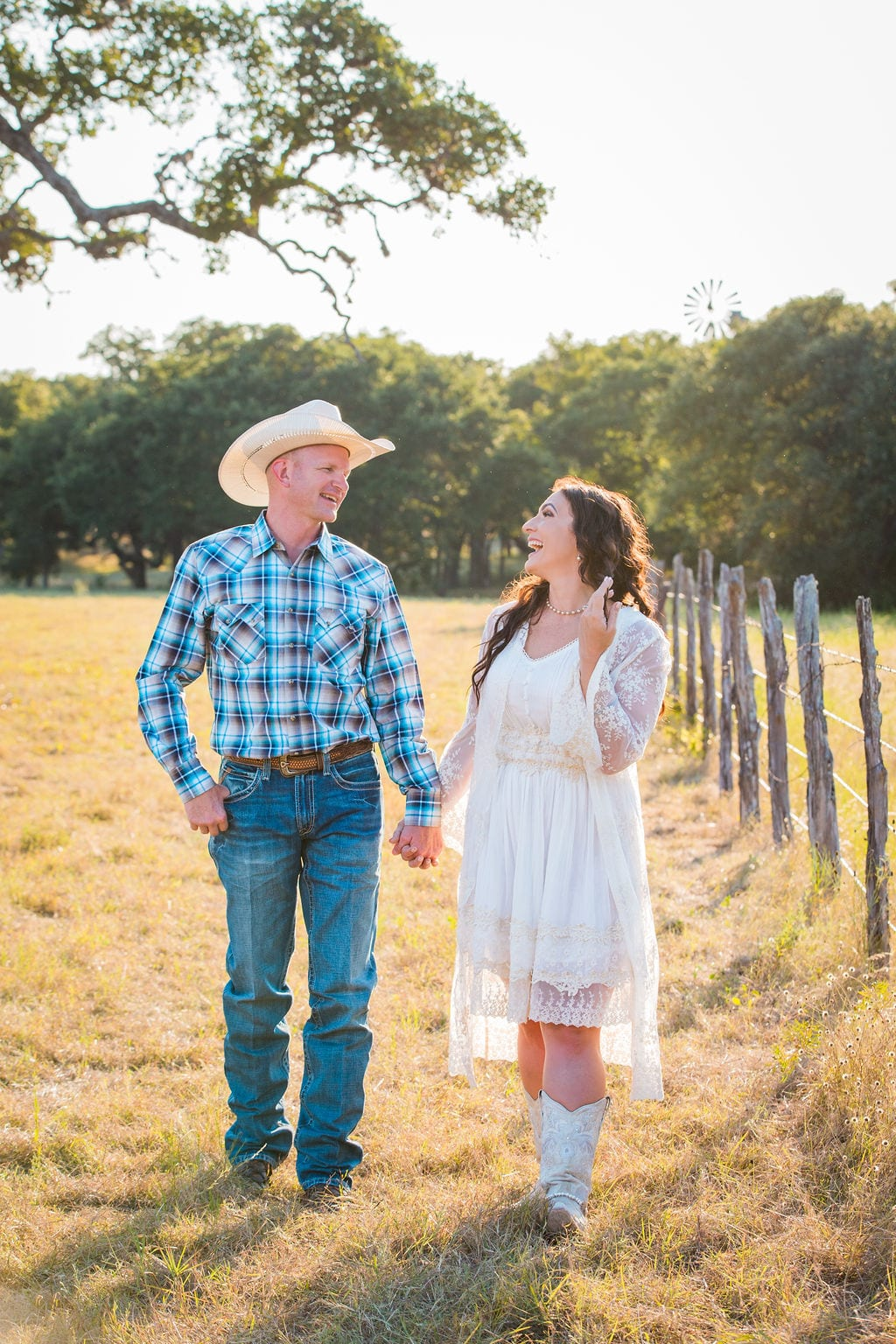 Tess -Lance Boerne, TX Engagement by the fence laughing