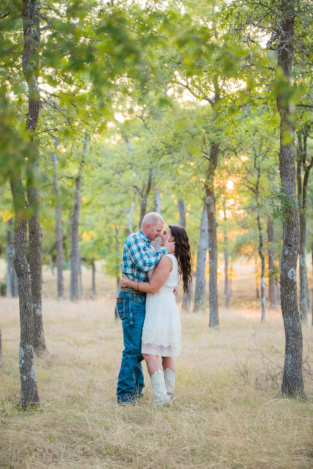 Tess -Lance Boerne, TX Engagement Portrait kiss in the trees