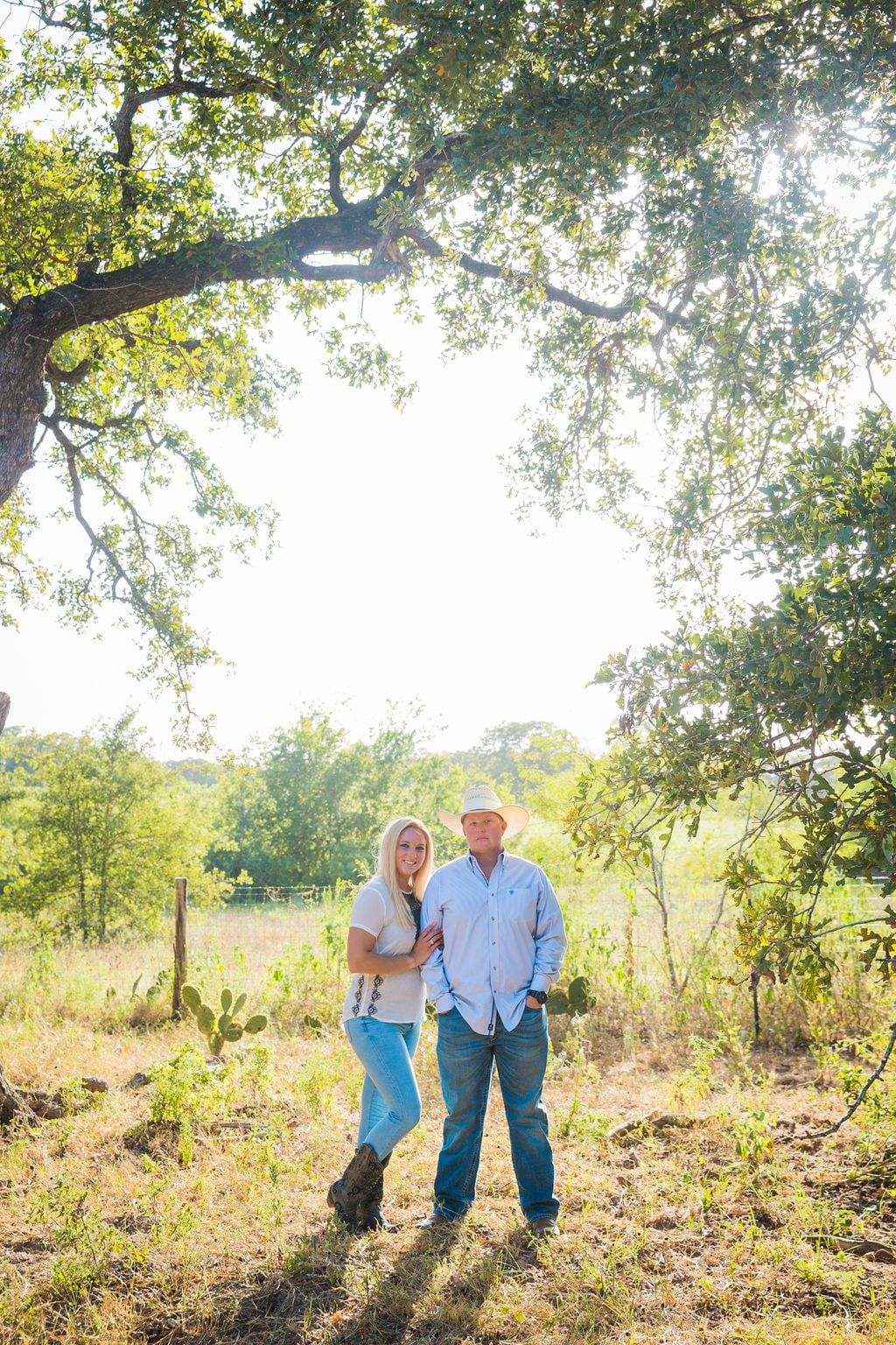 Whitney and Craig's ranch Engagement session under the tree