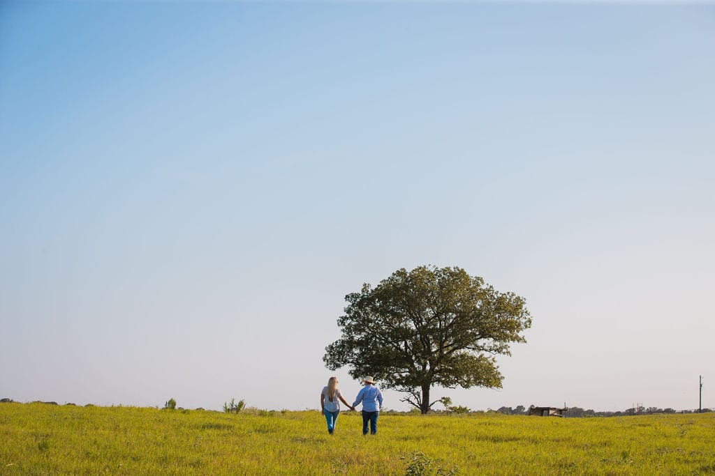 Whitney and Craig's ranch Engagement session toward the tree