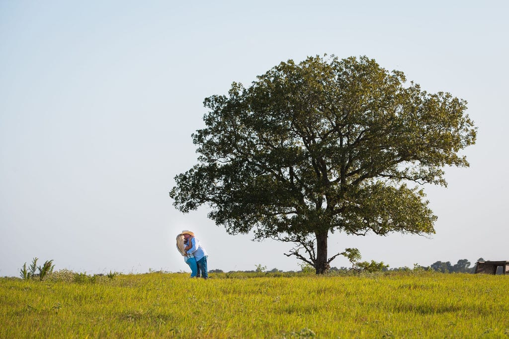 Whitney and Craig's ranch Engagement session lift at the tree