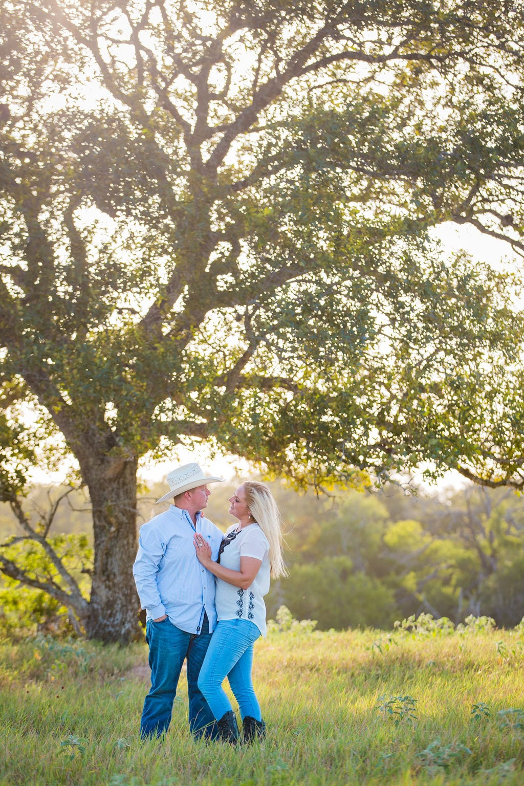 Whitney and Craig's ranch Engagement session dreamy at the tree