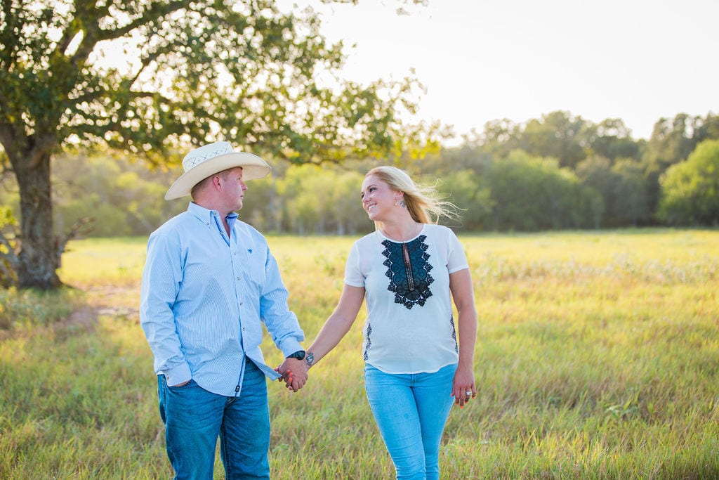 Whitney and Craig's ranch Engagement session walking