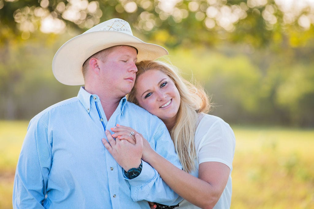 Whitney and Craig's ranch Engagement session shoulder hug
