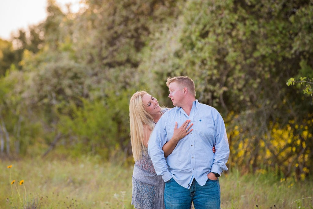 Whitney and Craig's ranch Engagement session back hug