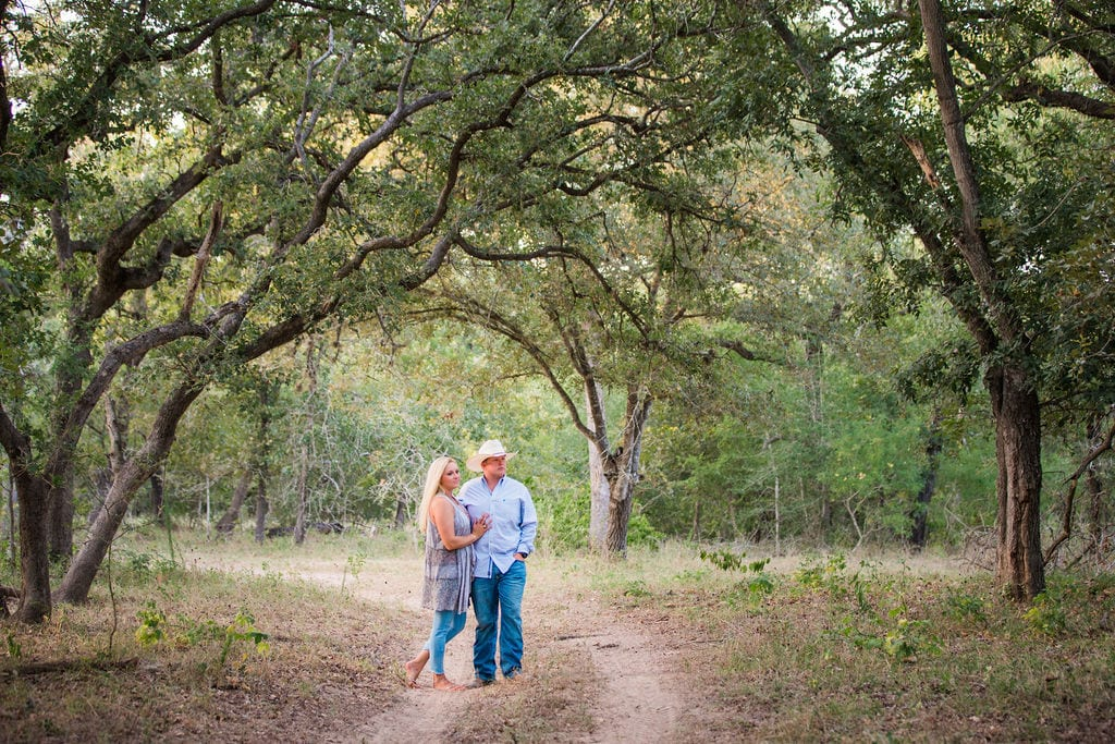 Whitney and Craig's ranch Engagement session on the path