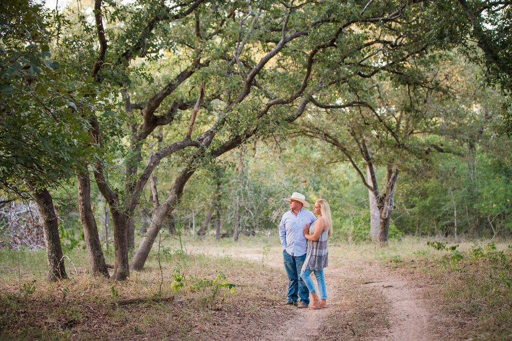 Whitney and Craig's ranch Engagement session on the path looking off
