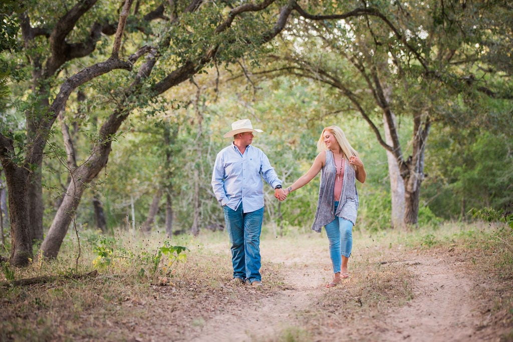 Whitney and Craig's ranch Engagement session on the path hair
