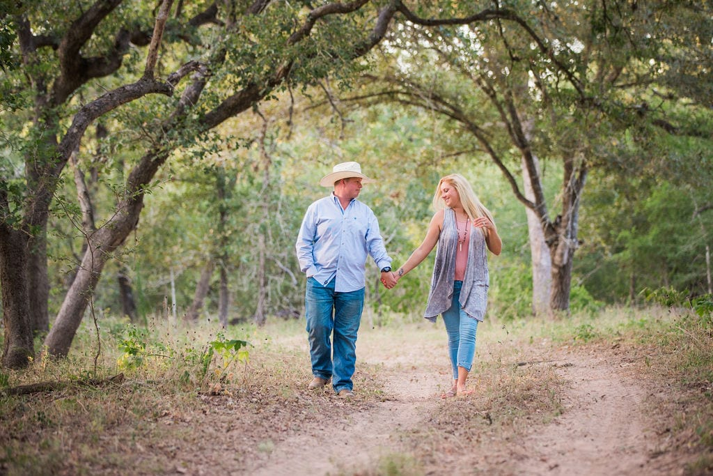 Whitney and Craig's ranch Engagement session on the path laughing