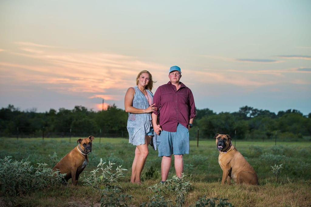 Whitney and Craig's ranch Engagement session at sunset with dogs