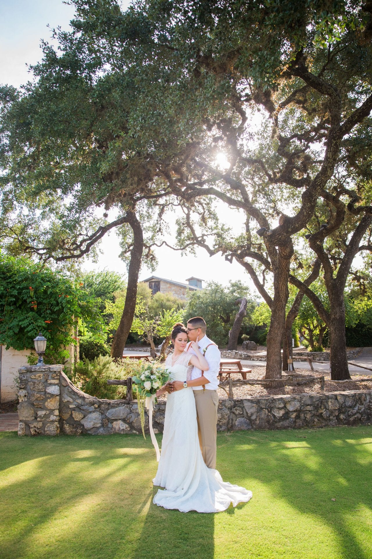 Aamber wedding Canyon Springs Golf Course couple by stone wall with sun