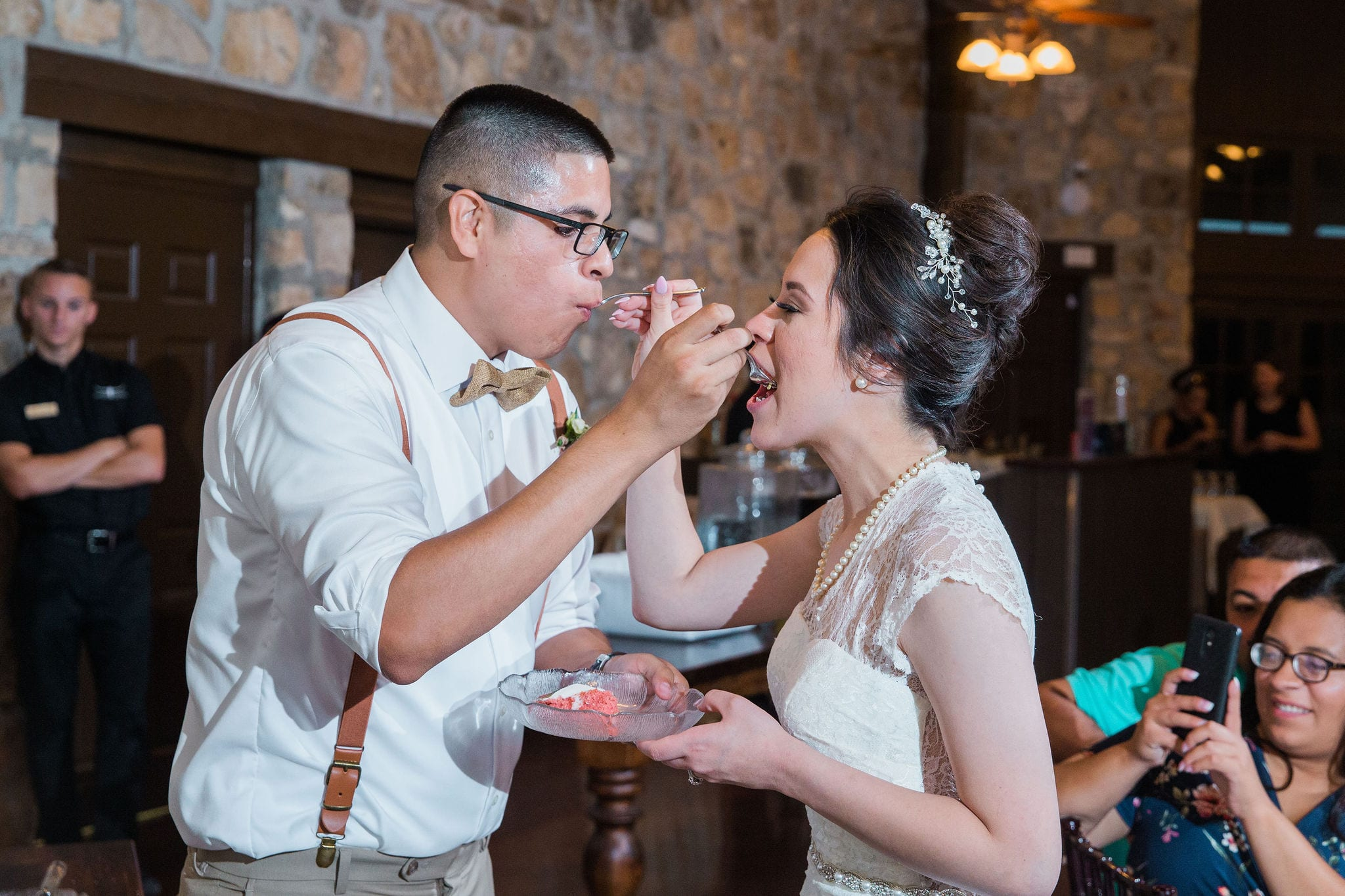 Aamber wedding Canyon Springs Golf Course cake feeding