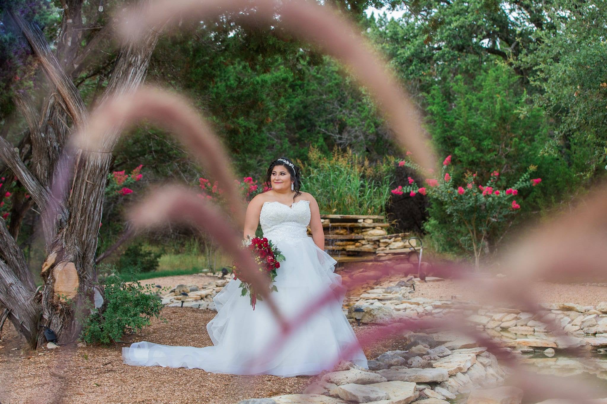 Laura's Bridals at Western Sky at the fountain through the grass