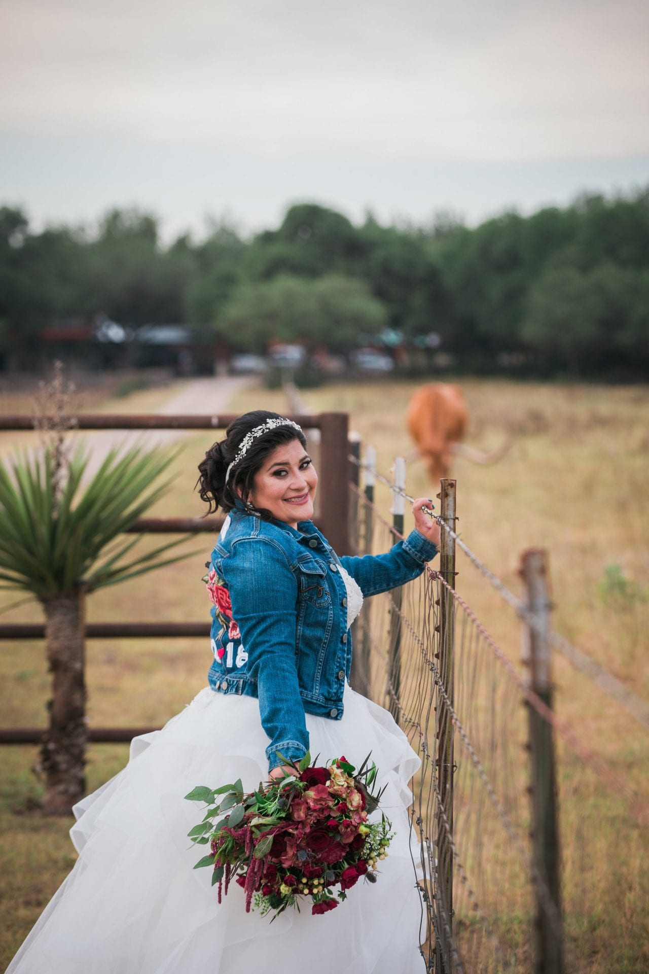 Laura's Bridals at Western Sky in the field at the gate