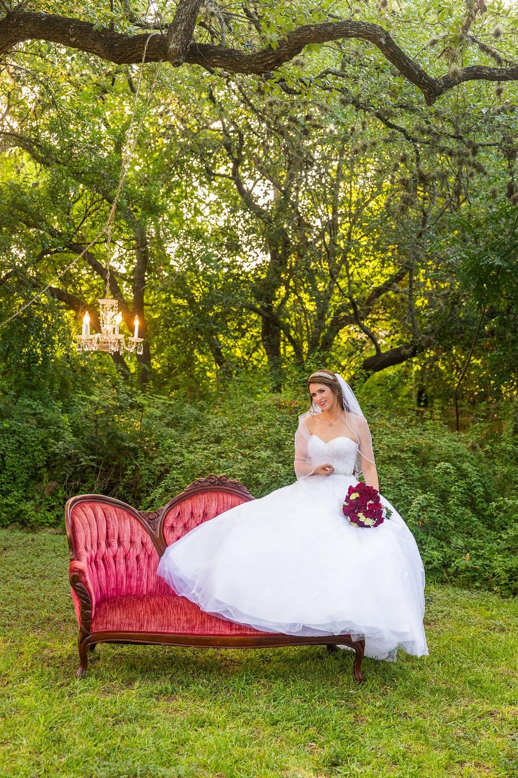 Laura's bridal at Landa Library on top of sofa long