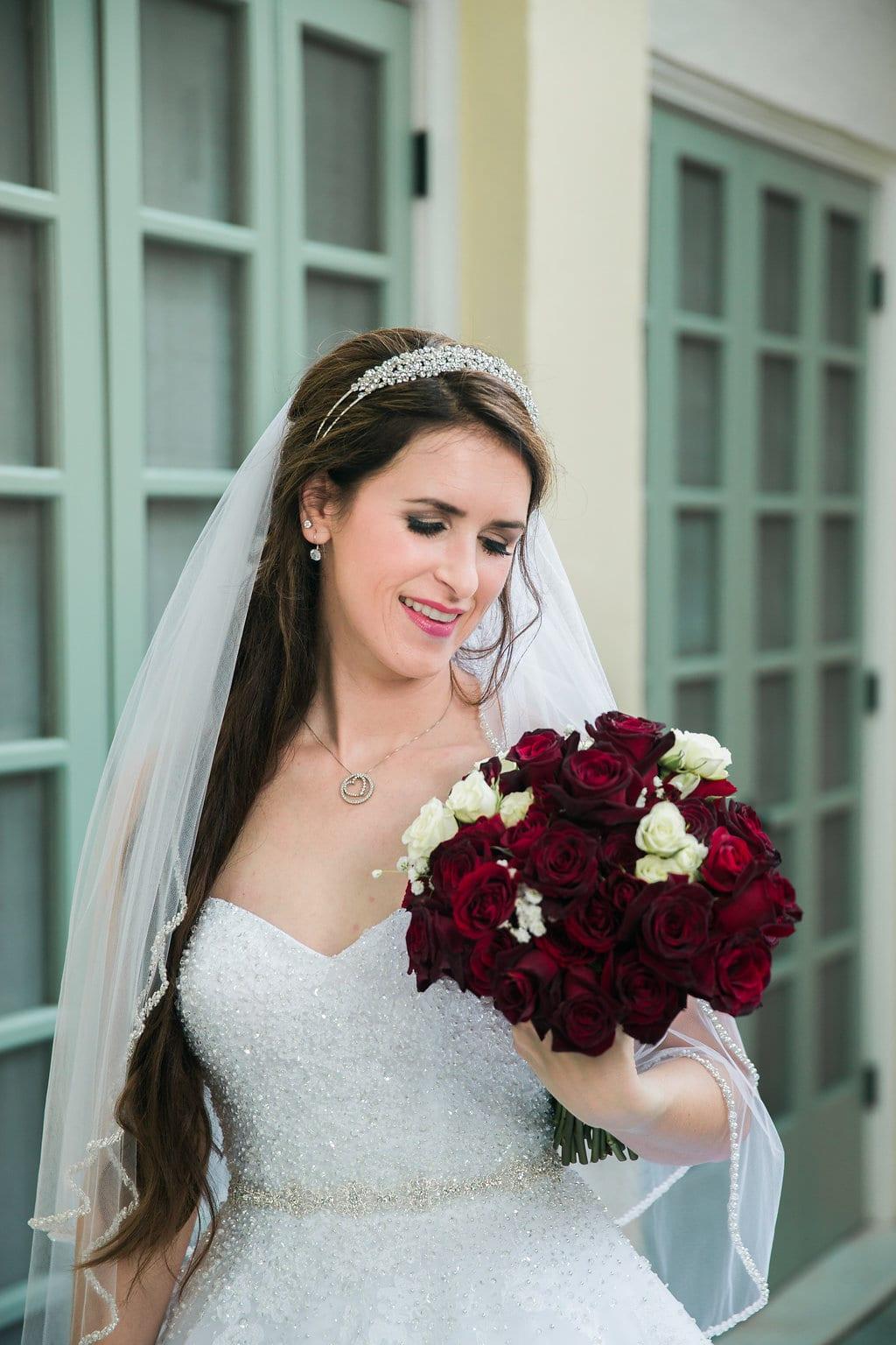 Laura's bridal at Landa Library window headshot looking at flowers