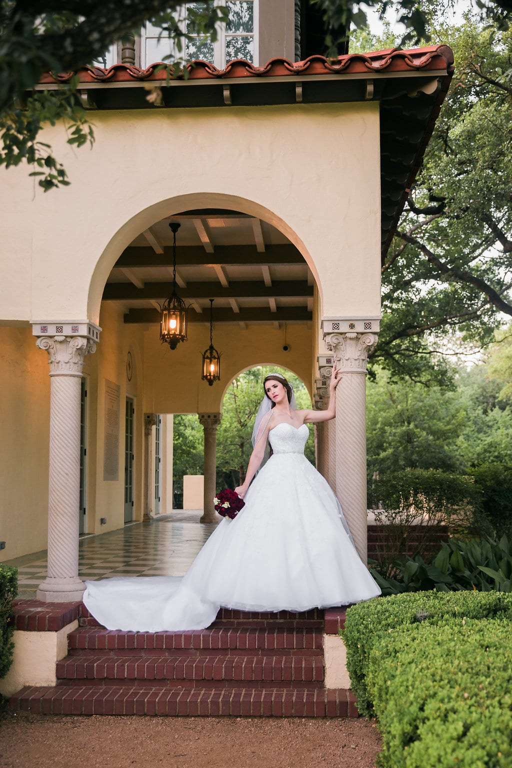 Laura's bridal at Landa Library arches and stairs ballerina pose
