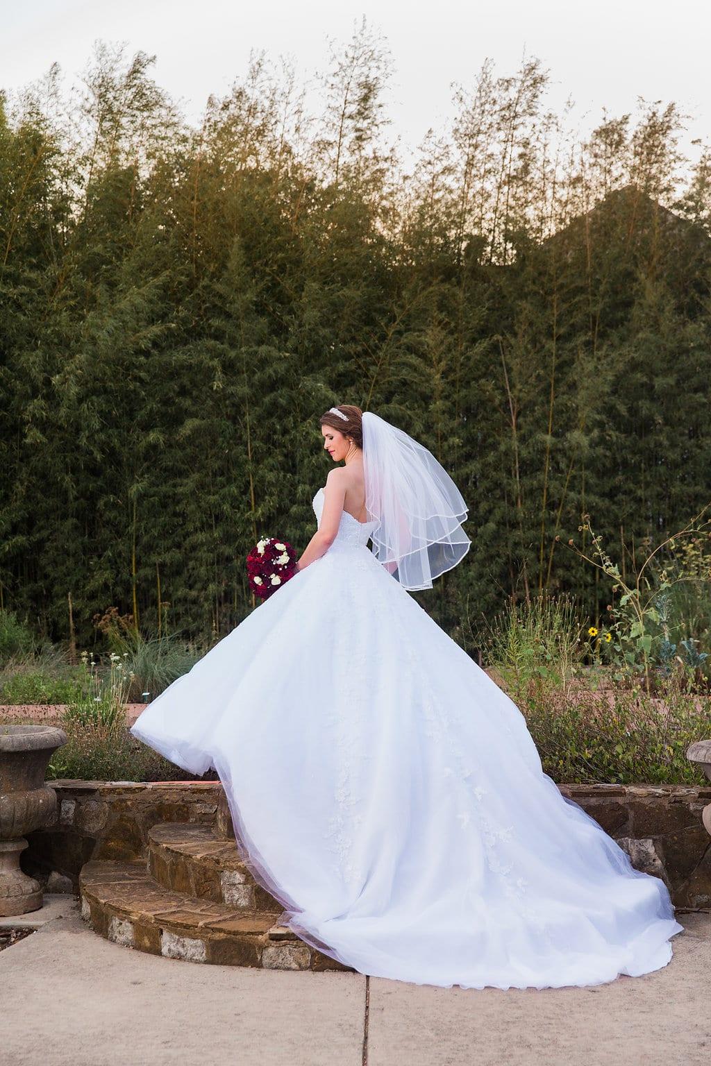 Laura's bridal at Landa Library garden brides back