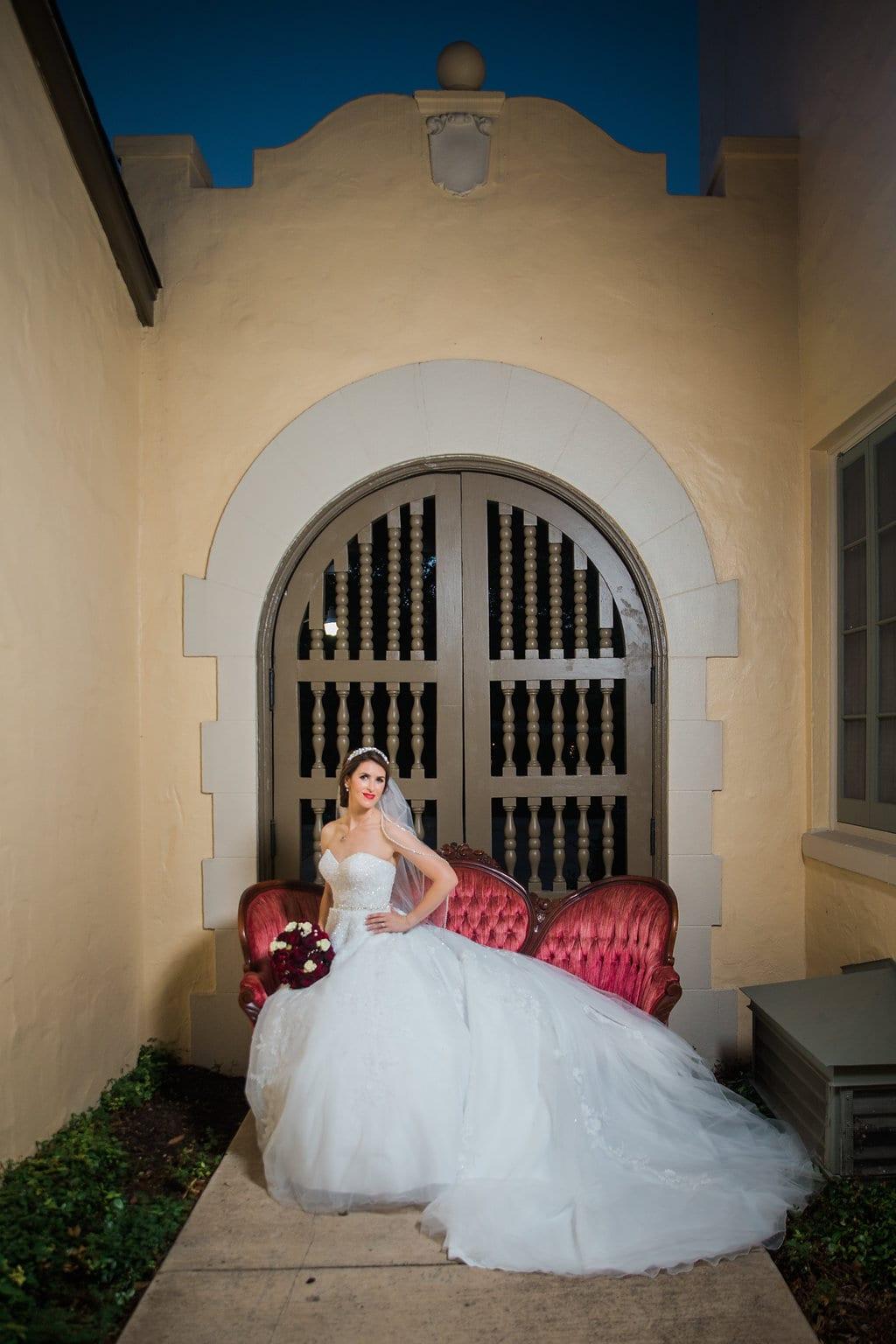 Laura's bridal at Landa Library gate bride on sofa